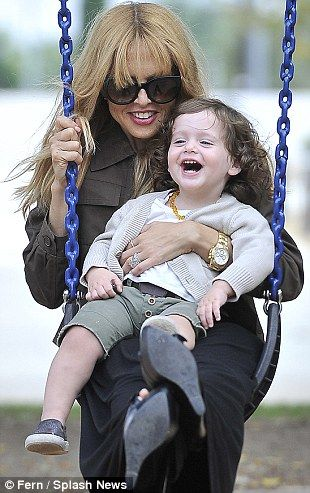 Swing when your winning: Little Skyler was clearly loving his time with his mother on the swing