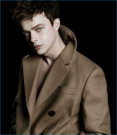 Dane DeHaan dons a sharp coat as the star of Prada L'Homme's fragrance campaign.