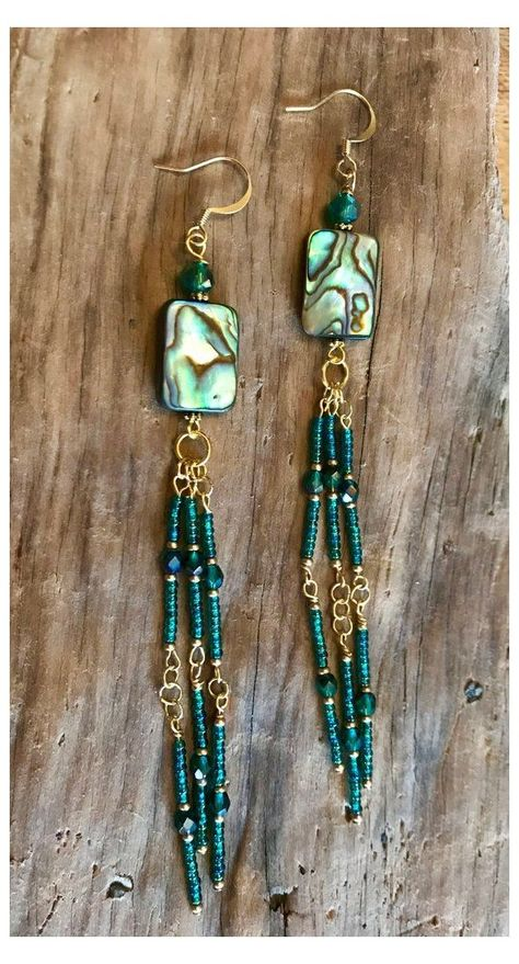Abalone & Seed Bead Earrings #seed #bead #earrings #patterns #simple #seedbeadearringspatternssimple These Earrings a boho beautiful! They are hand beaded with iridescent, blue green and gold seed beads with a crystal stone in between to catch your eye. The pieces of abalone shine bright with blues and greens.The are so beautiful and simple. Wire Wrapped Jewelry, Wire Jewelry, Boho Jewelry, Jewelry Crafts, Fashion Jewelry, Jewelry Ideas, Jewlery, Abalone Jewelry, Dainty Jewelry
