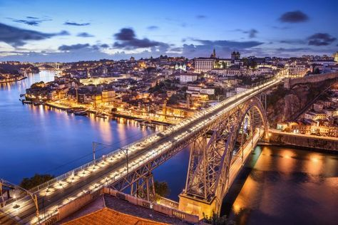 Porto, Portugal cityscape over the Douro River and Dom Louis Bridge.