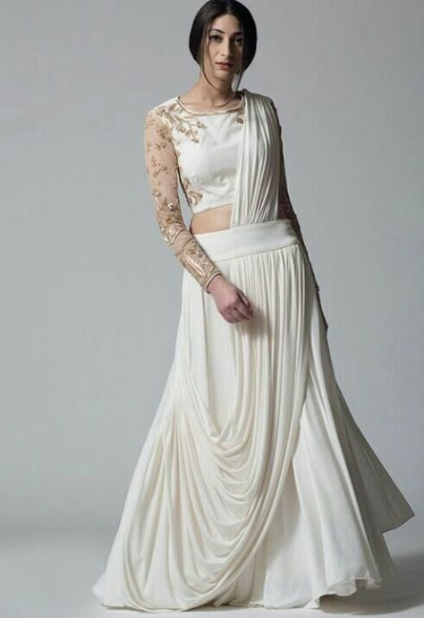 Ivory draped lehenga with ivory and peach embroidered blouse