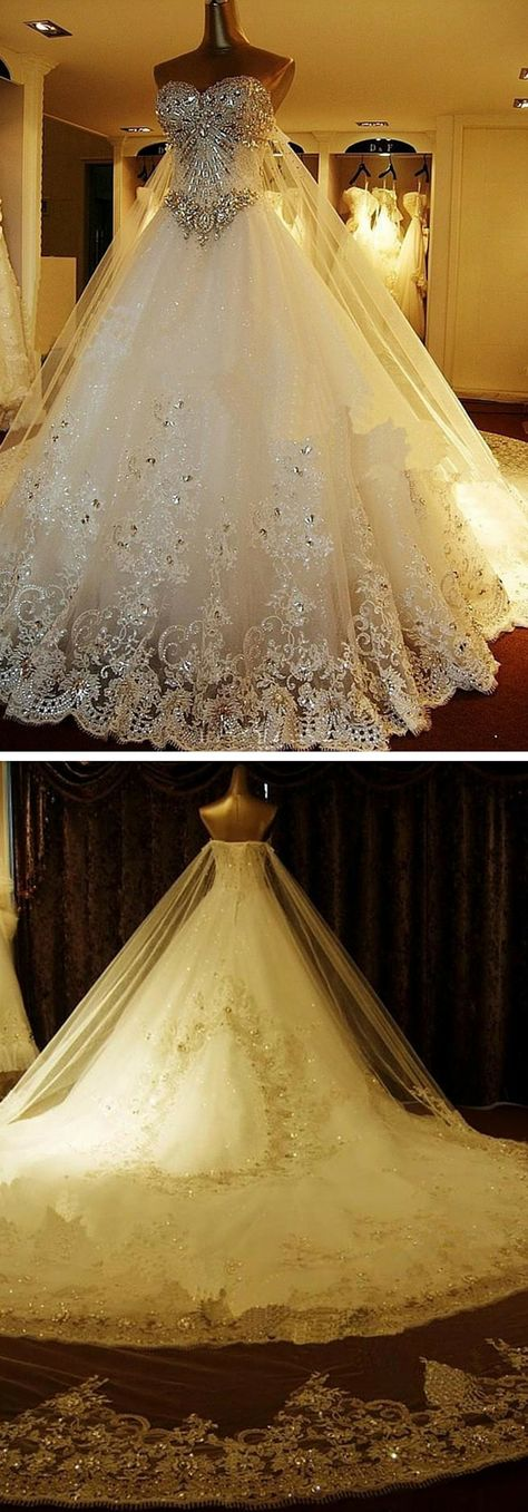 A glamorous jeweled and lace tulle cathedral wedding dress! This is an amazing choice for the bride who wants to make a statement. Use code PTL40331 to get an exclusive discount on it!