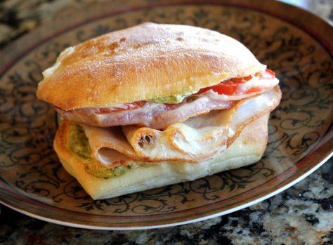 ---Costco Turkey Provolone Pesto Sandwich Melt---   5 square sandwich rolls (Torta or Cabaccia rolls)  1/2 C pesto  1/3 C mayonnaise (I used Best Foods Light)  1 pound sliced turkey breast  1 large tomato  1/2 red onion  5 slices provolone cheese