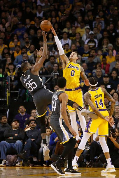 Kyle Kuzma of the Los Angeles Lakers blocks a shot by Kevin