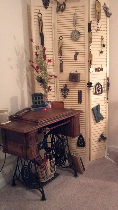 Old Singer Sewing Machine I got at a steal at an estate sale...great idea for displaying nick-nacks is the louvres.