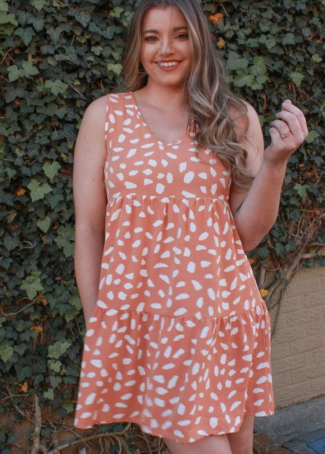 New Spring dresses are in! This salmon dress is adorable! The print is amazing and the v-neck and ruffle detailing as well! Jenna is wearing a small!
