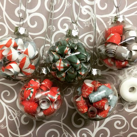 My 4th and 5th grade class made this craft....Tiny Christmas ornaments made from clear glass bulbs and scrapbooking paper rolled tightly around a wooden skewer/stick. Great for gifts, fine motor skills and a winter party. The bulbs are 1 1/2 inch in diameter, but any size bulb could be used. Many students planned to give them to family members as gifts.