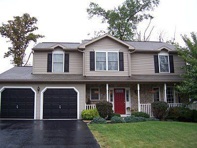 tan house black shutters red door - Google Search
