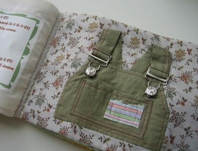 Quiet book.  Made from old baby clothing to teach how to fasten, zip, button, snap, etc.