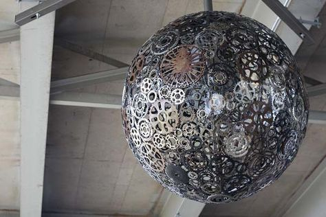 8.) Spare bike parts created this epic lamp.
