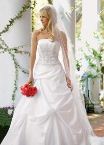 32302c50990 Satin and taffeta gown with beaded metallic lace on bodice and pick-up skirt .