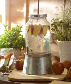 Throwing a party with a rustic theme or farmhouse flair? The Galvanized Beverage Dispenser is perfect! #kirklands #FrenchCountryDining #BeverageDispenser