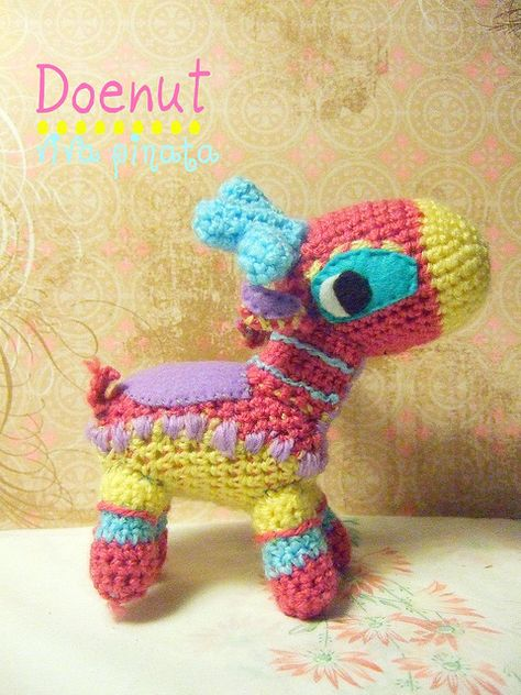 I haven't seen a crocheted Pinata before (real or toy) … Creative!     gamingurumi:    Doenut amigurumi by lines of equal loudness on Flickr.