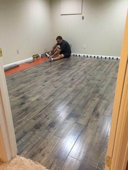 Our First Diy Project Laminate Flooring In Ben S Basement Office House Of Hepworths Basement Remodeling Basement Bedrooms Diy Basement
