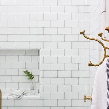 white subway tiled shower niche with