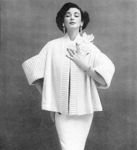 Dorian Leigh in suit by Lilli Ann, Vogue, January 1953