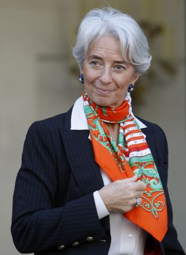 Add a pop of color to a conservative outfit with an orange printed scarf.