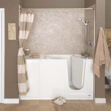 In this master bathroom remodel we installed a walk in bathtub and ...