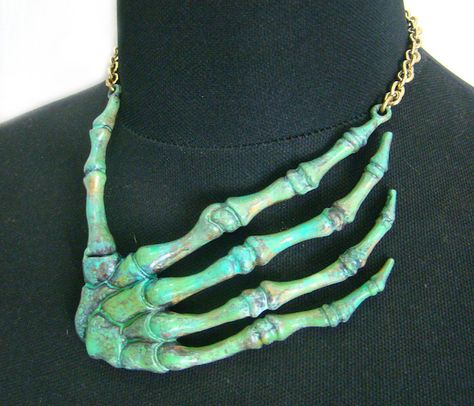 Patina Turquoise color  Strangle Bone Skeleton Hand necklace  in brass  design by Mafia by MafiaStudio on Etsy https://www.etsy.com/listing/210856611/patina-turquoise-color-strangle-bone