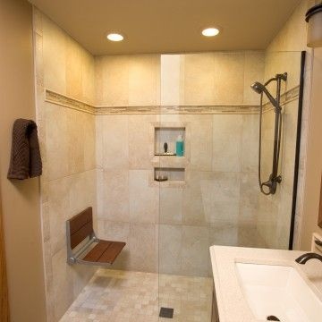 Accessible Bath Here An Attractive Tile Shower Includes A Seat That Folds Up When Not In Use Bath Remodel Remodel Shower Tile