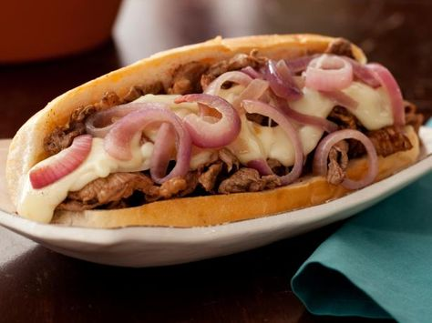 Get Philly Cheesesteaks with Melted Fontina and Sauteed Red Onions Recipe from Food Network