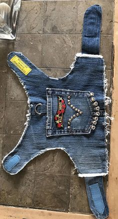 Denim Dog Vest with Wild Breed biker patch and studs. Even if your sidekick doesnt ride on the back, this mutt can strut his wild breed heritage. All DenimDawgs vests are made from recycled blue jeans with the best fashion labels. Nice and soft and just the right faded indigo color. A