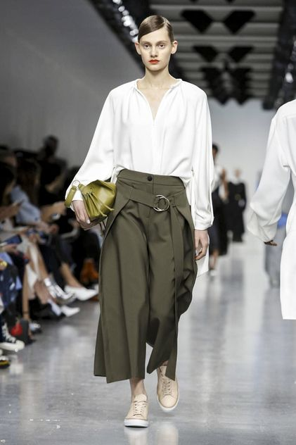 At Eudon Choi, the starting point may have been the austere Austrian modernist Adolf Loos - but the outcome saw Choi& slouchy, outsize separates energised with jolts of pumpkin, jade and French bl.