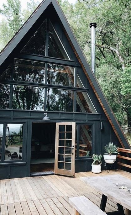 Black A Frame With Large Windows A Frame House House Exterior