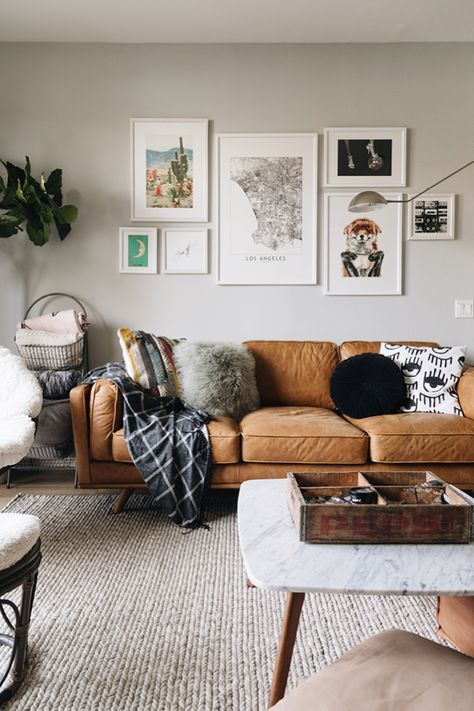 Warm Charme Tan leather and bright white accents come together to create this cohesive living and dining space. Photo by Drew Scott. #tanleathercouch #leathercouch #brownsofa