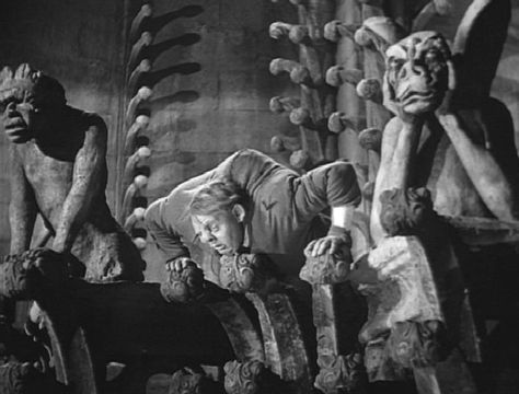 """Quasimodo (Charles Laughton): [to one of the stone gargoyles] """"Why was I not made of stone - like thee?"""" -- from The Hunchback of Notre Dame (1939) directed by William Dieterle"""