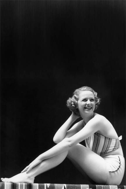 The History of the Bikini - In the 1930's and 40's the swimsuits shrink and start to show a sliver of midriff.