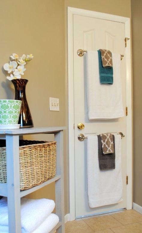 Bathroom idea - towel rods on back of door. To hide the holes in my old bathroom door?