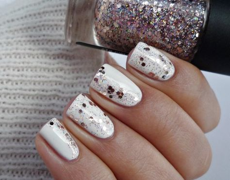 White crème and hex glitter polishes pair perfectly together in this mani. Check out what products you can use on your digits for this sparkly number.