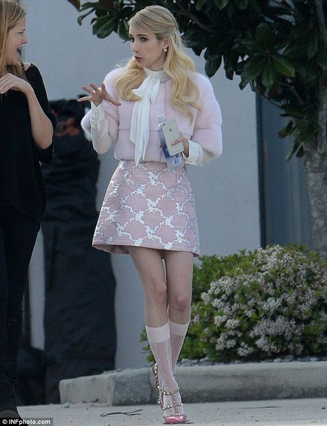 Breslin, Emma Roberts and Lea Michele wear pink while filming In character: Emma Roberts was in a pink outfit in between scenes .In character: Emma Roberts was in a pink outfit in between scenes .