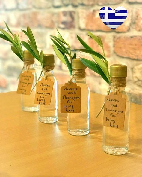 Homemade Greek Ouzo Bottle Wedding Favors Unique Party #greektraditionalfavors #greekbiofarm #greekouzofavors #greekoliveoilfavors #oliveoilbottles #oliveoilfavors #greekislands  #greekthemedwedding #greekwedding #ouzobottle #ouzodrink #oliveleaves