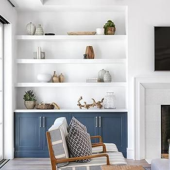White Floating Shelves Over Blue Built In Cabinets Built In