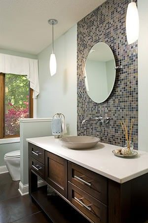 Guests Will Be Thrilled To Use This Main Level Bathroom With Vessel Sink And Accent Wall
