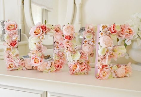 Pink, light pink LOVE flower letter set - This gorgeous flower letter set is made from paper mache letters which have been painted in metalic pink paint and filled with beautiful peach pink rose buds, light pink ranunculus white ranunculus, lovely light pink blushing bride and