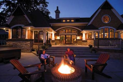 Installing a backyard fire pit creates a focal point to group furniture around and a cozy spot to share conversation and memories among family and friends on a cool evening.