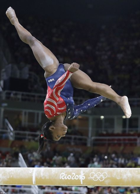 Team USA gymnasts make their first appearance in Rio United States' Simone Biles performs on the balance beam during the artistic gymnastics women's qualification Gymnastics Moves, Amazing Gymnastics, Gymnastics Pictures, Artistic Gymnastics, Olympic Gymnastics, Olympic Games, Gymnastics Videos, Tumbling Gymnastics, Gymnastics Flexibility