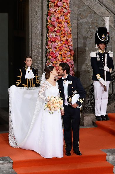 Prince Carl Philip of Sweden and his wife Princess Sofia of Sweden kiss after their royal wedding at The Royal Palace on June 13, 2015 in Stockholm, Sweden.
