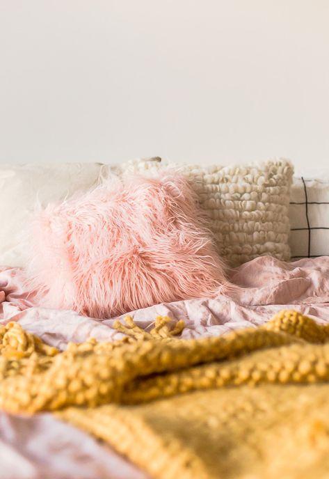 pink A light-filled, cozy bedroom...