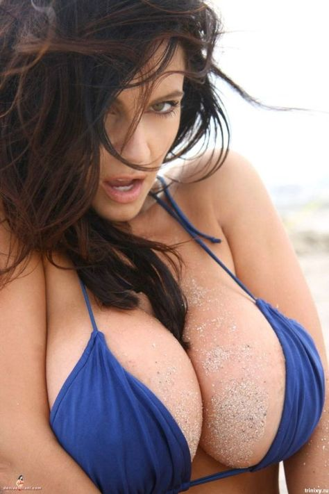 wonder if she needs some help getting that sand off her breasts?