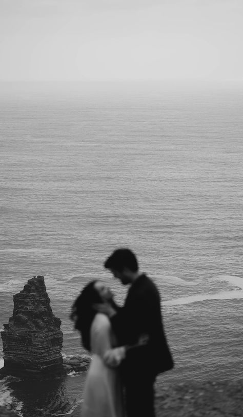 Romance and intimacy at the Cliffs of Moher in Ireland for this elopement shoot with Jacqui and Danny. Michael Toman is a creative director based in Ireland specialising in creating social and visual content for brands and fashion houses worldwide. #irelandphotographer #michaeltoman #cliffsofmoher #ireland #elopement #love #couple #coupleshoot #irelandphotographer