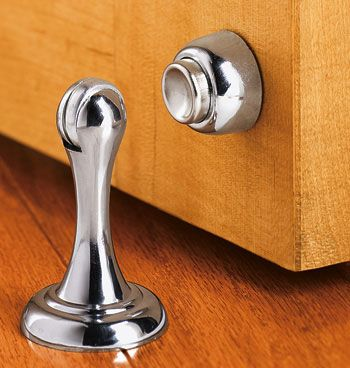 magnetic door stop i have these on all my doors keeps them neat against the wall and the wind never slams any shut can be mounted on the floou2026