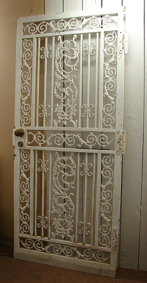 victorian house with wrought iron gate | White wrought iron
