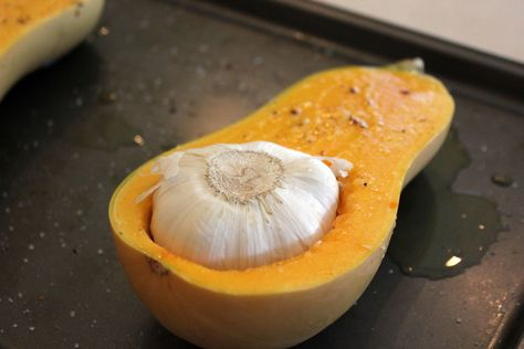 Roasted Garlic & Butternut Soup.  Love this concept of cooking the garlic with the squash.