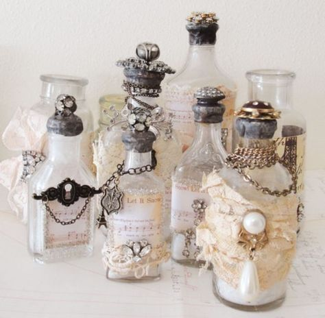 Create a pretty vintage bottle collection!  Use old broken jewelry , scrap booking paper scraps, fabric scraps and ribbon.  Hot Glue Gun, Super Glue or Mod Podge them onto the bottles.  A Great way to recycle all items.