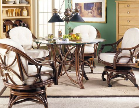 5-Piece Riviera Rattan Dining Set. The Riviera rattan set serves up contemporary and solid cane framing with stylized open petal insets on the table base and chair backs.