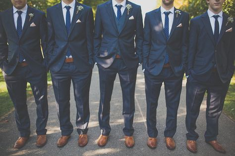 Groom and groomsmen to wear navy suits, navy patterned ties, and brown shoes (probably differing shades of brown)
